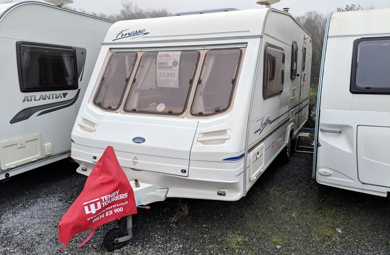 Touring Caravan for Sale: Sterling Finesse 520 2001 4 berth side dinette end washroom